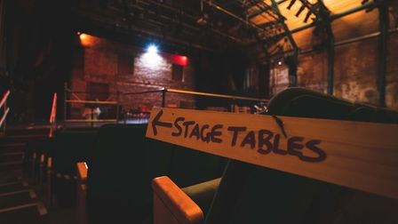 There is seating in the stalls, where trays have been added, and on the stage Picture: Max Hilton