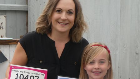 Clare and Isabelle Sayer are throwing a garage sale in Herthersett to fundraise for Cancer Research