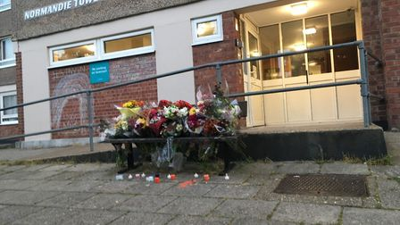 Floral tributes to Craig Stubbs, which were left at Normandie Tower in Norwich. Picture: Peter Walsh