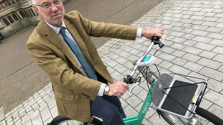 Norfolk County Councillor Martin Wilby on one of the new Beryl bikes. Picture: Lauren De Boise