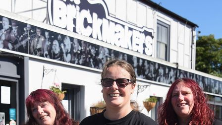Landladies of the Brickmakers, from left, Pam South, Emma Rose, and Charley South, who are holding B