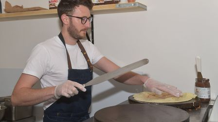 Owner Chris Smith making the crepes in his new shop Pictures: BRITTANY WOODMAN