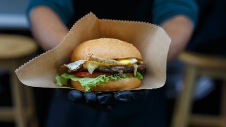 Serving up a burger at a street food festival (stock image) Picture: Getty Images/iStockphoto/Prosto