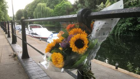 Floral tributes to Laurence Harvey who died in the River Wensum in Norwich. Picture: Simon Parkin