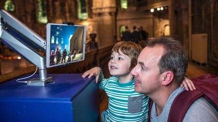 A young visitor enjoys an augmented reality display in the keep at Norwich Castle. Pic: Simon Finlay