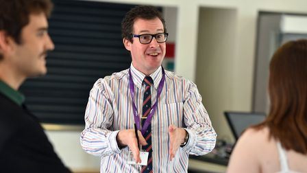 Teaching staff speaking to the students receiving their A-level results at Thetford Academy. Picture