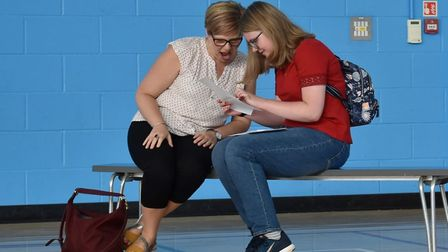 Jessica Fare (pictured with her mother) discovering GCSE grades at Hellesdon High School. Picture: W