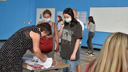 Pupils collect GCSE results at Hellesdon High School. Picture: Wensum Trust