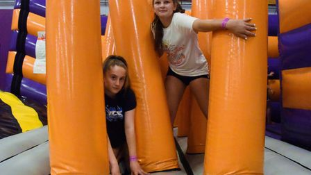 Hollie Clarke, left, and Bethany Dix, both 13, enjoying the new Wipeout style inflatable obstacle co