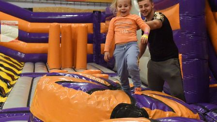 Four-year-old Amelia Sharp tackling the new Wipeout style inflatable obstacle course at Gravity with