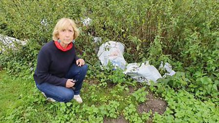 Councillor Caroline Ackroyd with rubbish left by Travellers onthe Danby Close parkland. Picture: Jam