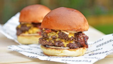 The Big Mother Fupper Burger includes two aged beef patties with pancetta bacon, American cheese, pi