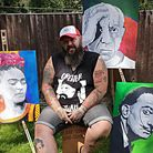 Artist Greater Than aka Justin Peach with a few of his latest commissions. The 40-year-old is making