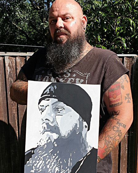 Artist Greater Than, aka Justiin Peach, whose painting giveaway stems from a belief that everyone sh