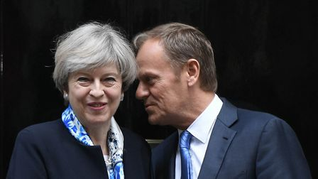 Prime Minister Theresa May greets European Council president Donald Tusk outside 10 Downing Street,