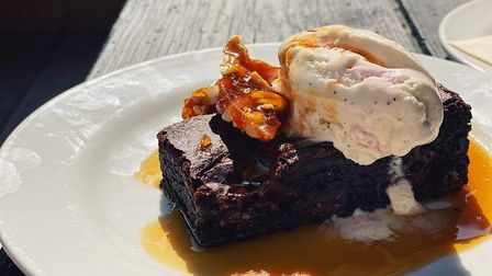 Chocolate brownies with salted caramel sauce, ice cream and peanut brittle from Too Fat Roasties at
