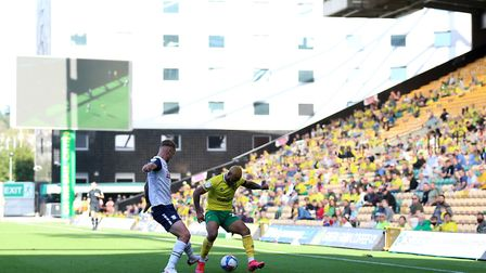 Norwich City's Onel Hernandez and Preston North End's Patrick Bauer battle for the ball as fans watc