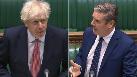 Boris Johnson (L) and Keir Starmer in the House of Commons during PMQs