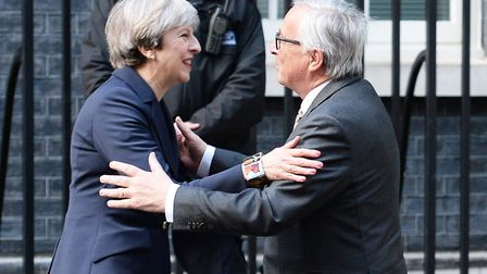 Prime Minister Theresa May greets European Commission President Jean-Claude Juncker