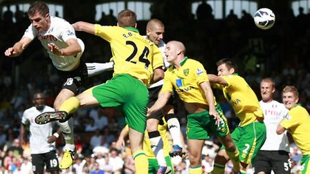Fulham's Mladen Petric rises highest to notch his second in Norwich City's 5-0 opening day Premier L