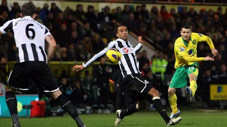 Wes Hoolahan tries to find a gap in the Magpies rearguard - but has his shot charged down. Pictire: