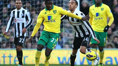 Alex Tettey battles Newcastle's James Perch for the ball. Picture: Paul Chesterton / Focus Images