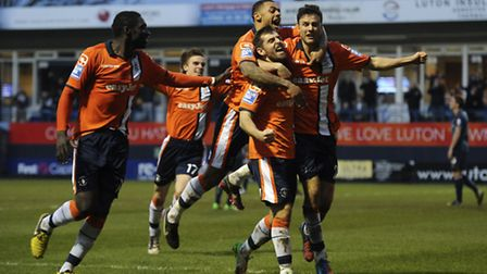 Luton players celebrate the goal from Alex Lawless that gave them victory in round three.