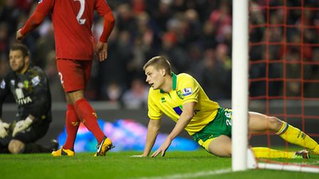 Ryan Bennett looks dejected after scoring an own goal to hand Liverpool their fifth goal. Picture: D