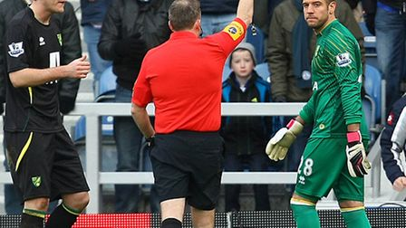 Mark Bunn joins a lengthening list of Norwich City bookings from referee Jon Moss at Loftus Road on