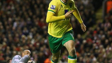 Grant Holt celebrates his equaliser in the 1-1 draw at Anfield when Norwich City played Liverpool la