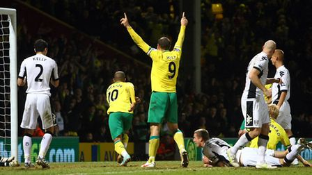 Grant Holt celebrates Simeon Jackson's equaliser when Norwich City and Fulham drew 1-1 in the corres