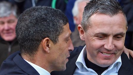 Luton Town manager Paul Buckle embraces his old pal Chris Hughton before kick-off at Carrow Road. Pi