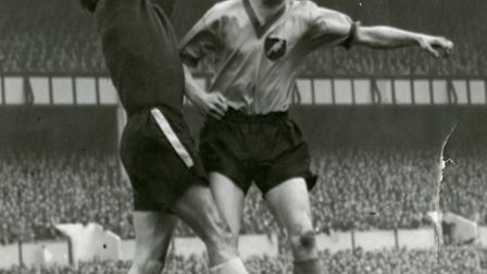 Norwich City's Terry Allcock jumps with Luton Town goalkeeper Ron Baynham.