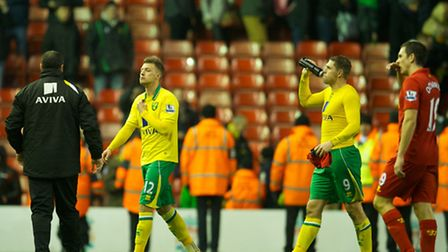 Norwich City's Grant Holt and Anthony Pilkington walk off dejected after losing 5-0 at Liverpool. Pi