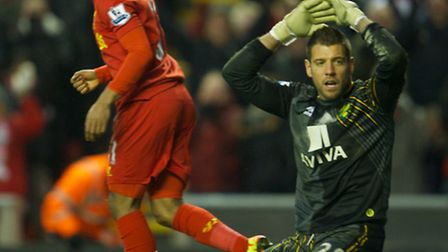 Mark Bunn looks dejected after a Ryan Bennett own goal gave Liverpool a 5-0 win. Picture: Dave Rawcl