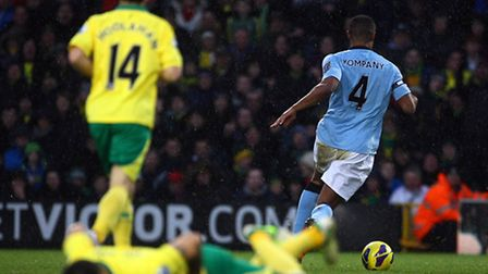 Not this time - Vincent Kompany races clear following his heavy challenge on Bradley Johnson, who wa