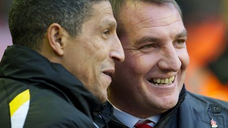 The two managers enjoy a joke before the game. Brendan Rodgers' smile lasted longer. Picture: Dave R