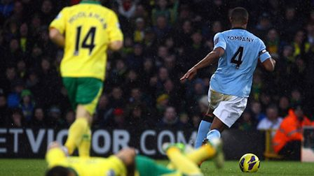 Bradley Johnson is left in a crumpled heap by a hard challenge from Vincent Kompany in the move that
