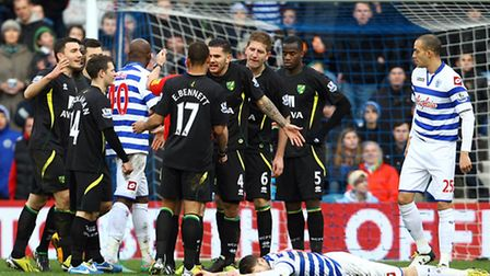 Bradley Johnson leads the protests to referee Jon Moss over a free kick awarded to QPR. Picture: Pau