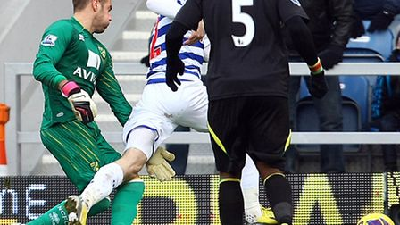 QPR's Jamie Mackie wins a penalty after being felled by Mark Bunn. Picture: Paul Cheesterton / Focus