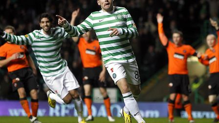 Gary Hooper celebrates after opening the scoring for Celtic against Dundee United on Tuesday night.