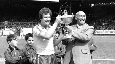 Joe Royle, left, receives the player of the season trophy from Geoffrey Watling at Carrow Road in 19