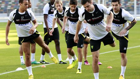 Norwich City players go through their routines at the Zayed Sports City Stadium in Abu Dhabi.