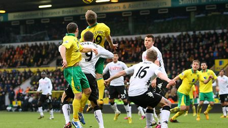Luciano Becchio wins a header on his Carrow Road debut. Picture: Paul Chesterton / Focus Images