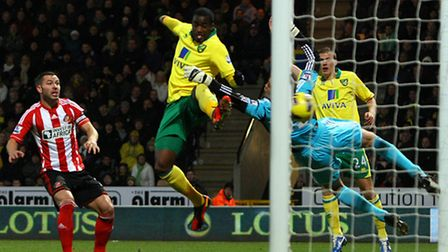 Sebastien Bassong finds the target in Norwich City's Carrow Road win over Sunderland in December. Pi