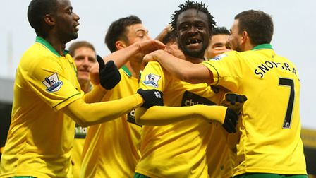 Kei Kamara celebrates his first goal for Norwich City with his team mates. Picture: Paul Chesterton