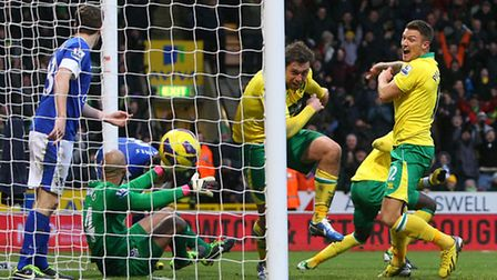 Anthony Pilkington and Grant Holt celebrate the Norwich City captain's winning goal. Picture: Paul C