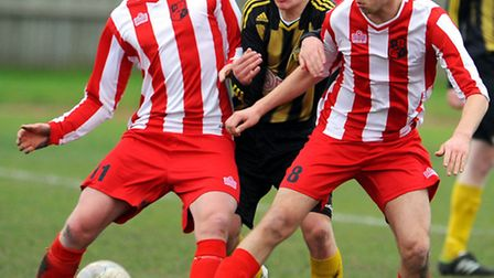 A Great Yarmouth player is outnumbered during the 3-3 draw against Halstead. Picture: James Bass
