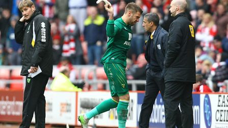 Mark Bunn throws off his gloves in disgust following his red card at Sunderland. Picture by Paul Che