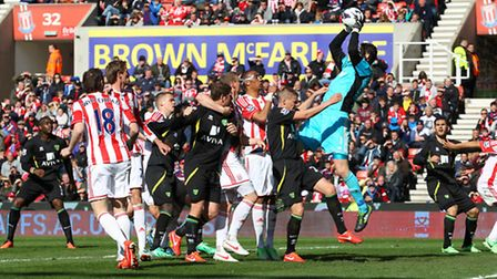 Stoke goalkeeper Asmir Begovic collects the ball safely in a crowded penalty area. Picture: Paul Che